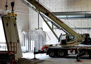 A crane lifting a large object.