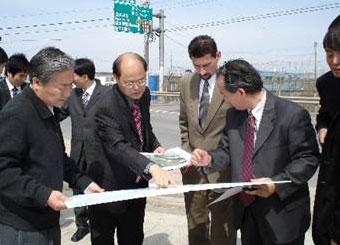 People looking over a blueprint in Korea.