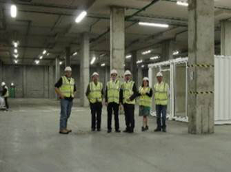 Construction workers standing in a row.