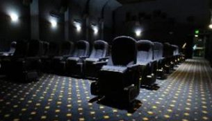 Chairs in a dark room.
