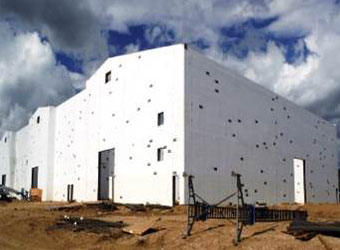 A white building being built.